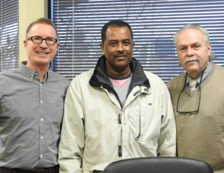 Demisse Tulu, along with broker Pat Paulson of Exit Realty Metro (left) and loan officer Jeff Gessell of US Bank Home Mortgage