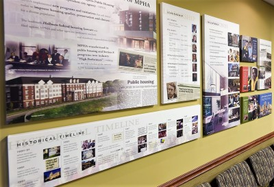 Panels at MPHA Headquarters show the history of the agency