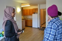 Residents and MPHA staff examine the planned upgrades for The Snellings, at an open house in January 2018