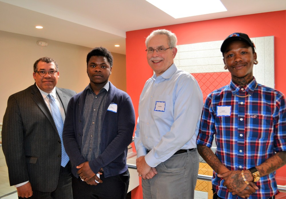 CEO Paul Williams of PPL and Executive Director Greg Russ of MPHA, with Downtown View residents Pierre and Avanti