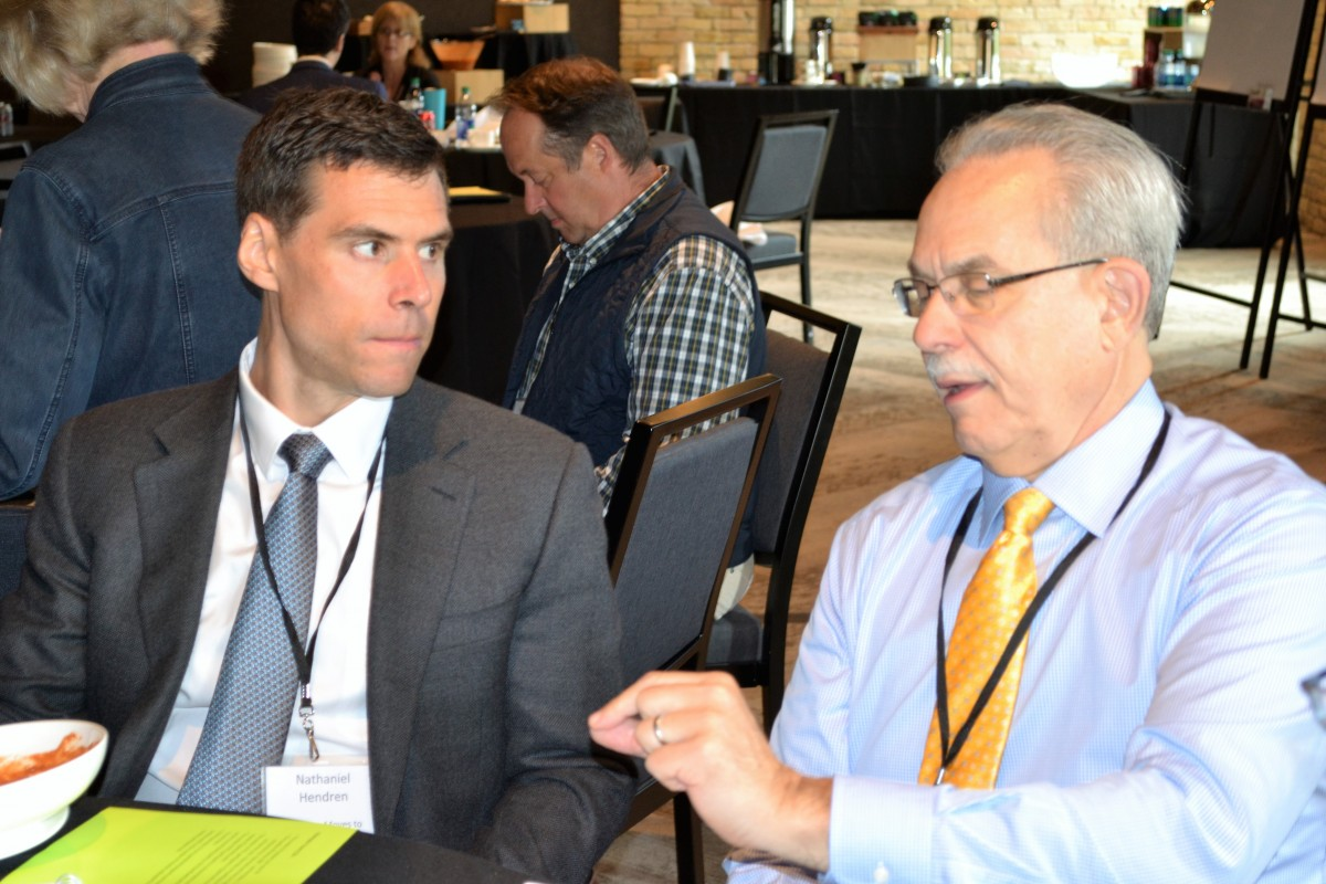 """Harvard economist Nathaniel Hendren (left) with MPHA Executive Director Greg Russ at """"Thinking Locally, Solving Regionally"""" in August 2017"""