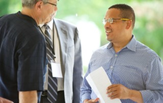 Congressman Keith Ellison with MPHA Executive Director Greg Russ