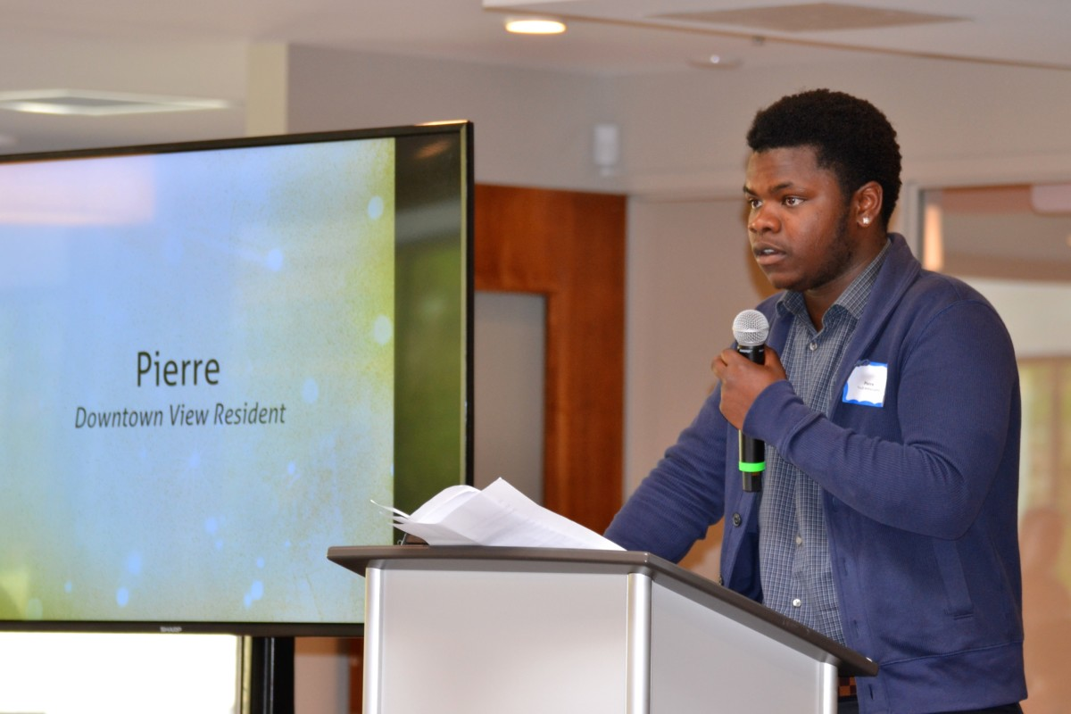 Resident Pierre shares his journey at the grand opening for Downtown View