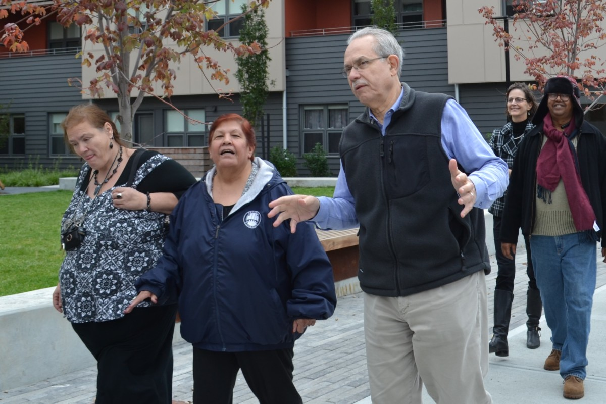 Greg Russ with residents in Cambridge